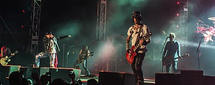 "Guns N' Roses in Bangalore in 2012. From left to right, Richard Fortus, Axl Rose, Ron ""Bumblefoot"" Thal, DJ Ashba and Tommy Stinson Guns N' Roses in Bangalore 2012-12-07-0068 (8401973216).jpg"