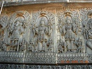 Trimurti - An art depiction of the Trimurti at the Hoysaleswara temple in Halebidu.