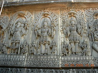 Hinduism - Temple wall panel relief sculpture at the Hoysaleswara temple in Halebidu, representing the Trimurti: Brahma, Shiva and Vishnu