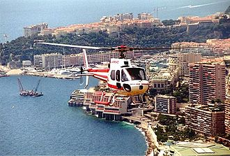 Heli Air Monaco - Eurocopter AS350 of Heli Air Monaco flying over the Vista Palace Hotel in Monte Carlo.