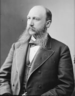 A black and white photographic portrait of a bearded Henry M. Mathews.