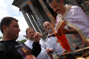 "Religion in Armenia - Hetan ""fire and sword"" ritual of initiation at the Temple of Garni of Mihr-Vahagn."