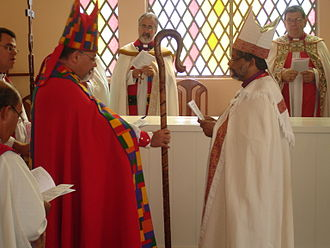 Clergy - Bishop Maurício Andrade, primate of the Anglican Episcopal Church of Brazil, gives the crosier to Bishop Saulo Barros.