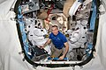 ISS-59 David Saint-Jacques works on EMUs inside the Quest airlock.jpg