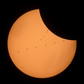 ISS Transit composite during Solar Eclipse 8-21-17 near Banner, Wyoming.jpg