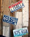 Idaho Michigan and Missouri license plates.jpg