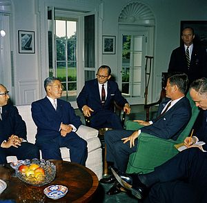 Angier Biddle Duke - Meeting with the Prime Minister of Japan Hayato Ikeda. (L-R) Japanese Minister of Foreign Affairs Zentaro Kosaka, Prime Minister Ikeda, Counselor of the Ministry of Foreign Affairs (Interpreter) Toshiro Shimanouchi, President John F. Kennedy, State DepartmentChief of Protocol Angier Biddle Duke (standing), and interpreter James J. Wickel. Oval Office, White House, Washington, D.C.