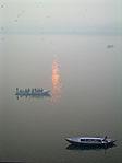 India - Varanasi - 018 - Foggy sunrise on the Ganga (2146271247).jpg