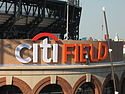Citi Field logo being installed on the stadium