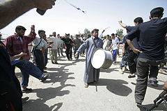 Iraqi civilians play music and dance at a ceremony commemorating the opening of a civilian road outside Forward Operating Base Omar, near Karmah, Iraq, April 14, 2008, during Operation Iraqi Freedom 080414-M-RF524-010.jpg