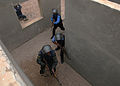 Iraqi police students practice clearing a building at the police academy in Basra, Iraq, April 20, 2011 110420-A-YD132-148.jpg