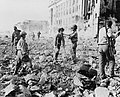 Japanese troops wounded surrender to US and Filipino soldiers in Manila 1945.jpg