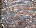 Jaspilite banded iron formation (Soudan Iron-Formation, Neoarchean, ~2.69 Ga; Stuntz Bay Road outcrop, Soudan Underground State Park, Soudan, Minnesota, USA) 38 (19039516099).jpg