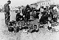 Jewish street vendors in a marketplace in Lowicz.jpg
