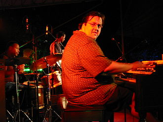 "Organ trio - Jazz organist Joey Defrancesco, pictured here in 2002, has recorded albums that recapture the ""old school"" organ trio sound of the 1960s."