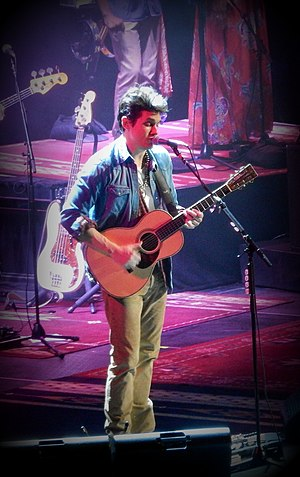 John Mayer - Mayer performing at the Barclays Center in Brooklyn, New York, on December 17, 2013