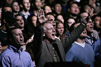 John Piper (theologian) - Piper during worship in 2008