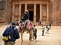 """Jordan, Petra. Tourists on camels in front of the famous monument """"Treasury of Pharaoh"""".jpg"""