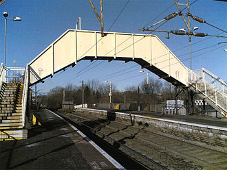 Side platform - Jordanhill railway station, in Scotland, with two side platforms, and a footbridge connecting them.