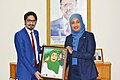 Junaib Abbasi presented portrait of H.E.Mrs Khadija Mohamed Almakhzumi .jpg