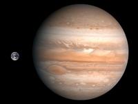 Größenvergleich zwischen Erde und Jupiter (maßstabsgerechte Fotomontage).