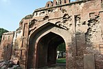 Kashmiri Gate and portion of the City Wall on either side of the Kashmiri Gate on the side and on the other up to and including the water Bastions at the Northern corner of the wall and also including the dith outside the City wall where this is exposed.