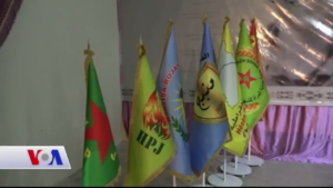 Kurdistan Communities Union - Flags of several KCK-affiliated groups during a conference in Kobanî, 2017