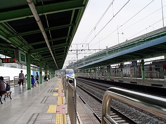 Geumcheon-gu Office Station - Geumcheong-gu Office station platforms. Here, a high-speed train is shown bypassing the station.