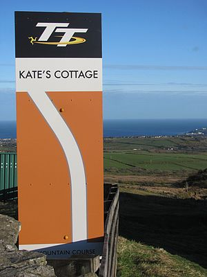 Kate's Cottage, Isle of Man - Roadside racemarker on the A18 Snaefell Mountain Road with a south-eastly aspect looking towards Douglas