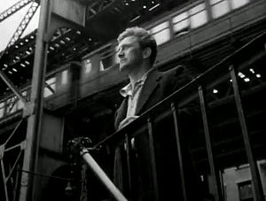 Young Man with a Horn (film) - Kirk Douglas in Young Man With a Horn, Third Avenue El in background.