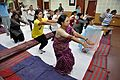 Knee Movement - Loosening Practice - International Day of Yoga Celebration - NCSM - Kolkata 2015-06-21 7310.JPG