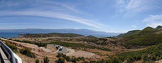 Albanian Ohrid Lake Coast - Panoramic view above the village of Lin and Ohrid Lake in the background.
