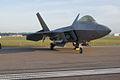 Lockheed-Martin F-22A-30-LM Raptor 05 107 RSideFront Dawn SNF 04April2014 (14399772049).jpg