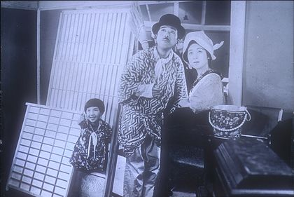 Director Heinosuke Gosho's Madamu to nyobo (The Neighbor's Wife and Mine; 1931), a production of the Shochiku studio, was the first major commercial and critical success of Japanese sound cinema. MadamuTonyobo.jpg