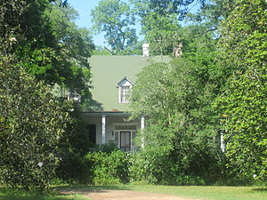 Magnolia Plantation (Derry, Louisiana) - Shown here hidden by trees is Magnolia Plantation House, located in the Cane River Creole National Historical Park in south Natchitoches Parish.