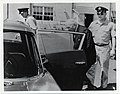 Mark Bortman enters a car with unidentified members of the U.S. Air Force (12617979523).jpg
