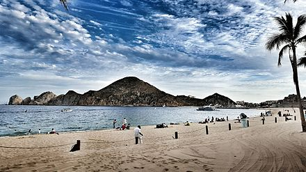 Medano is the main beach of Cabo San Lucas, pictured here with Land's End in the background Medano lands end.jpeg