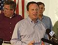 Michael Brown speaks alongside Jeb Bush and Mel Martinez.jpg