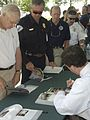 Michael D. Brown signs books for firefighters.jpg