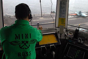 Modern United States Navy carrier air operations - The miniboss oversees flight operations from Primary Flight Control