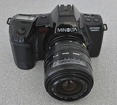 Minolta Dynax 7000i Analogue Film Camera, With Sigma 28-70mm Lens (8744220568).jpg