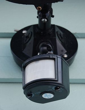 A motion detector attached to a garage.