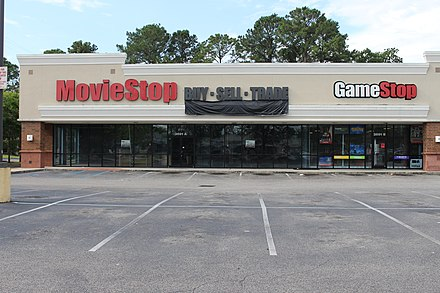 A shuttered MovieStop store and a GameStop store in Mobile, Alabama in 2018