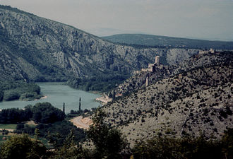 Neretva - Lower Neretva Valley - pictured from behind the walls of Počitelj, looking upstream towards Počitelj village and its Citadel, and further behind Mostar.