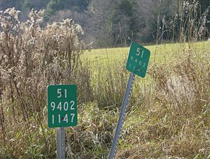 New York State Route 51 - Old and new style reference markers on NY 51 in Otsego County between Morris and New Lisbon