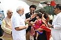 Narendra Modi being received by the Governor of West Bengal, Shri Keshari Nath Tripathi and the Minister of State for Heavy Industries & Public Enterprises, Shri Babul Supriyo, on his arrival, in West Bengal.JPG