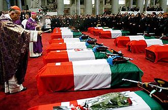 Military funeral - State funeral for the soldiers fallen during the Nasiriyah bombing, celebrated by Cardinal Camillo Ruini in the Basilica of Saint Paul Outside the Walls, 18 November 2003