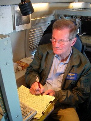 Bill Nelson - Sen. Nelson works with government storm trackers during a hurricane-hunter flight into the center of Hurricane Charley in August 2004
