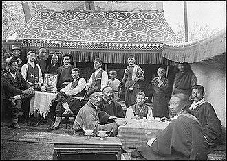 Lhasa Newar - Newar traders listening to the gramophone and playing Chinese dominoes (bha), Lhasa, 1921.