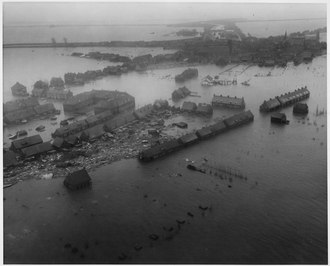 A town in Zuid Beveland inundated in 1953. Netherlands. Viewed from a U.S. Army helicopter, a Zuid Beveland town gives a hint of the tremendous damage wrought... - NARA - 541705.tif
